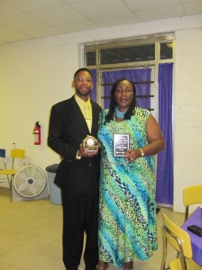 Shaaron accepts an award from Arise from the Ashes and her husband, Derrick accepts an award for supportive husband